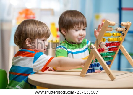 preschooler children boys play with counter toy