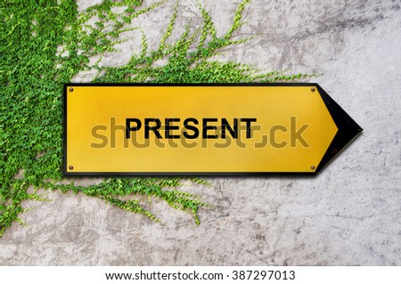 Present on yellow sign hanging on ivy wall
