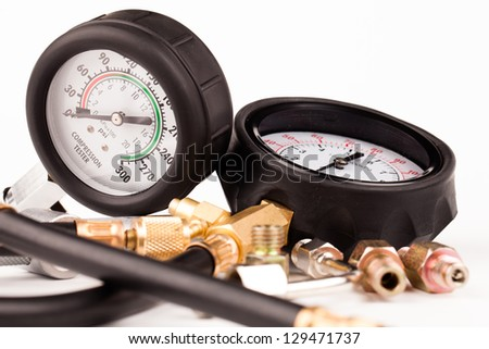 pressure gauges and tools isolated on white