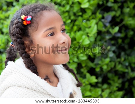 Pretty African American Girl With Braids Outdoors