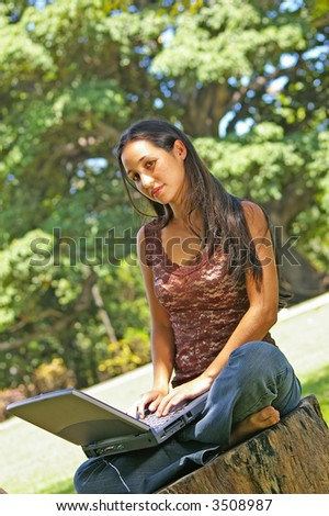 pretty african-american teen on laptop
