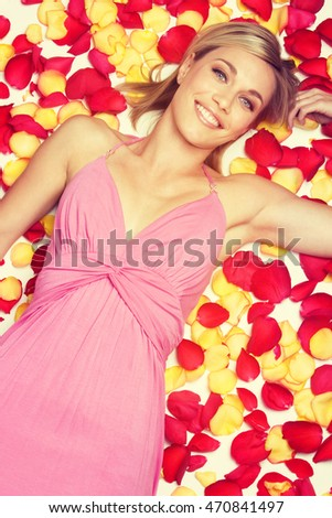 Pretty blond woman laying in petals
