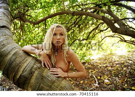 Pretty Blond woman with braids nude in the forest