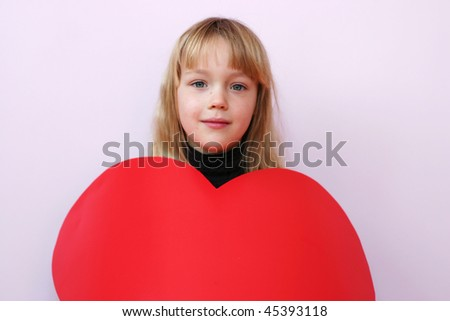 Pretty blonde girl  in heart-shaped costume