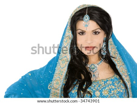 pretty brunette wearing traditional indian outfit on white