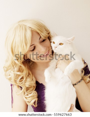 Pretty girl holding a kitty