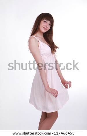 pretty girl in a white dress with a good mood