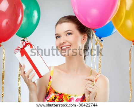 Pretty girl with color balloons