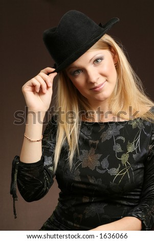 Pretty girl. Young woman on dark background