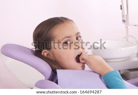 pretty little girl in dentist chair