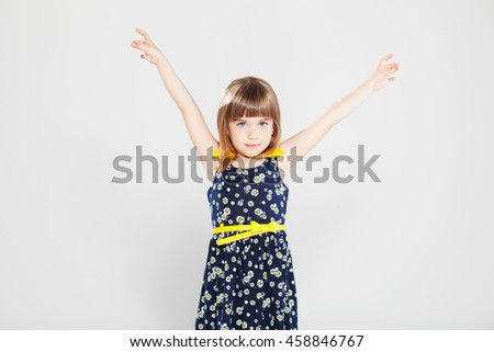 Pretty little girl  in studio on gray background