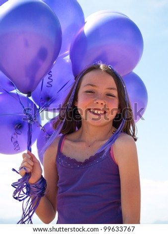 Pretty little girl with baloons in hand
