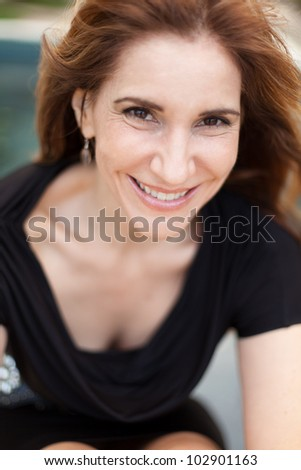 Pretty middle age woman outdoor portrait.