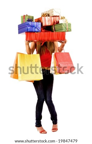 Pretty shopping girl hold many gift boxes and bags.