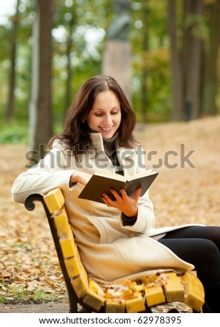 pretty woman reading book and smiling