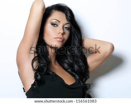 Pretty woman with beauty long brown hair - posing at studio