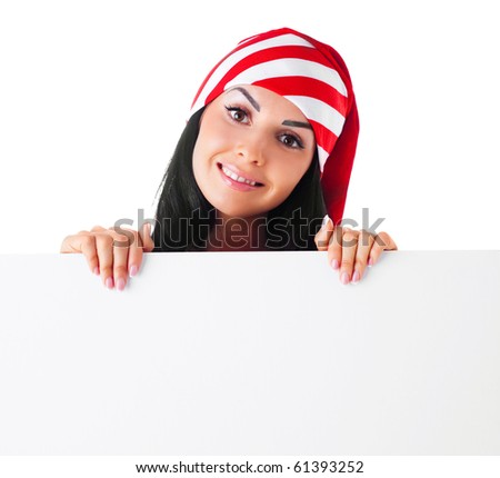 pretty young brunette woman wearing a Santa's hat hiding behind a blank sheet of paper