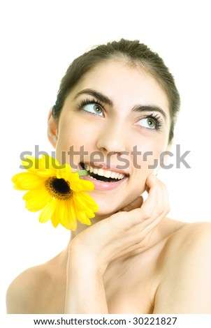 pretty young dreamy woman with a yellow flower in her mouth