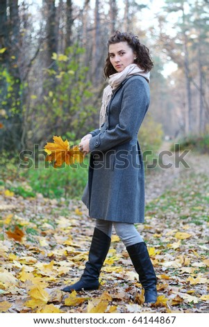 pretty young girl in autumn fores  in coat