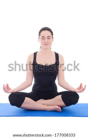 pretty young woman in a meditative yoga pose isolated on white background