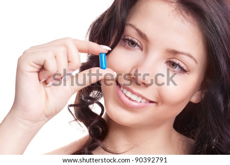 pretty young woman taking pills, isolated against white background