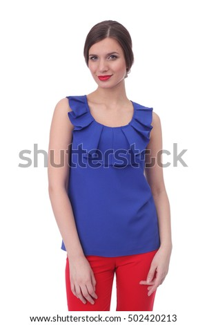 pretty young woman wearing summer blue blouse and red pants