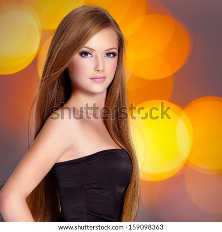 Pretty young woman with beautiful long straight  hair and attractive face