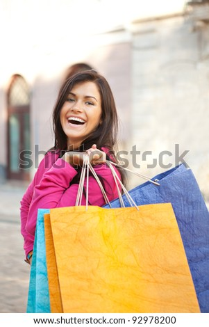 Pretty young woman with shopping bags in the city. Shopping concept