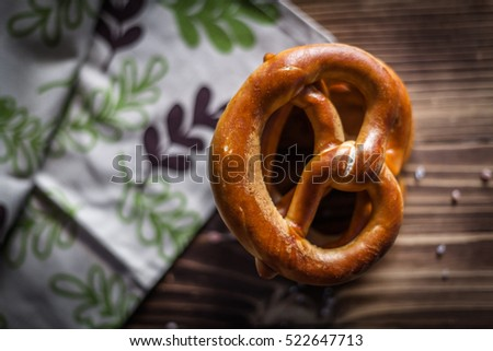 Pretzel on a wooden cutting board