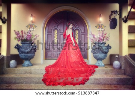 Princess in red dress at the castle