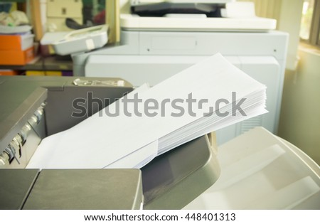 printer tray in copy machine with paper