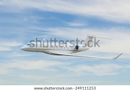 Private jet airplane flying in sky