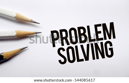 Problem solving memo written on a white background with pencils
