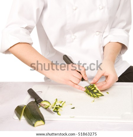 Process of carving a Zucchini isolated on white background