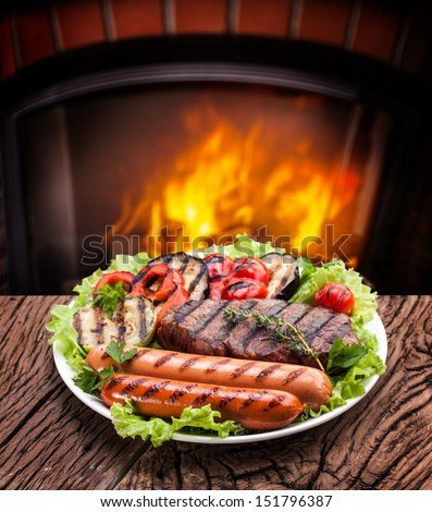 Products grill: steak, sausage and vegetable on a plate.