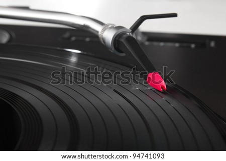 Professional DJ audio equipment - turntable record player with high-class spherical needle. Closeup shot of tonearm on the vinyl disc.Disc jockey professional technology to play music