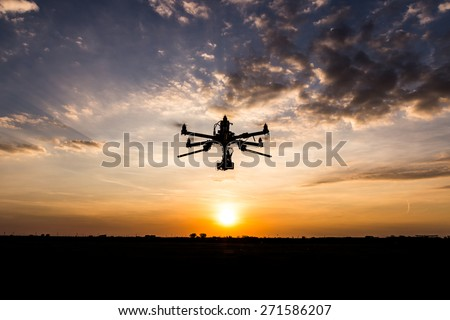 Professional drone flying in the sunset