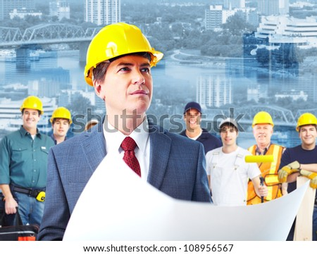 Professional engineer and a group of industrial workers. Construction.