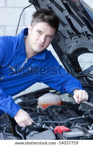 Professional man repairing a car in a garage