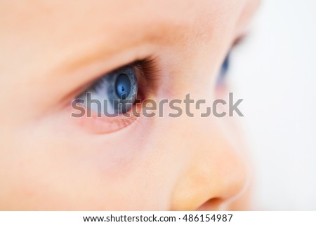Profile of a child with deep blue eyes