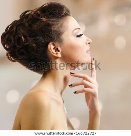 Profile portrait of a beautiful young woman with black nails  - side view