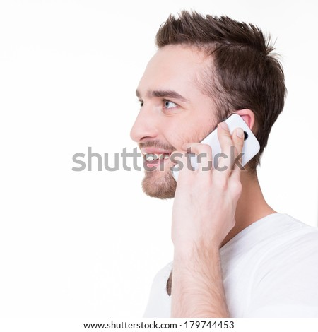 Profile portrait of  happy man calling by mobile in casuals - isolated on white. Concept communication.