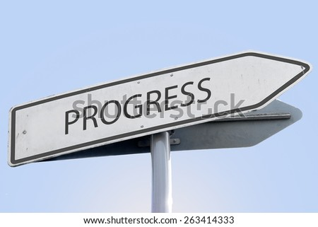 PROGRESS word on road sign