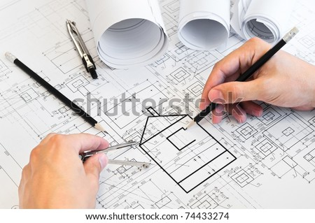 Project drawings and human hands drawing a house by pencil on paper