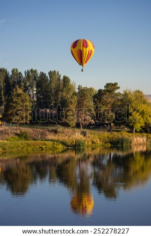 PROSSER, WA - SEPTEMBER 27, 2014. Giant balloons are flying over Yakima river. The 25th Annual Giant Balloon Rally in Prosser