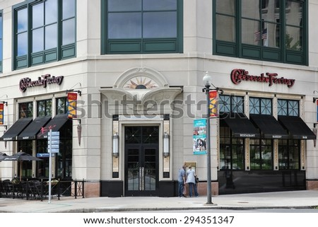 PROVIDENCE, USA - JUNE 8, 2013: People walk by Cheesecake Factory restaurant in Providence. The company has 185 full-service restaurants.