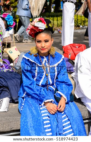 PUEBLA, MEXICO - OCT 30, 2016: Unidentified girl dressed the national costumes for the Day of the Dead (Dia de los Muertos), national Mexican holiday, UNESCO Intangible Cultural Heritage of Humanity