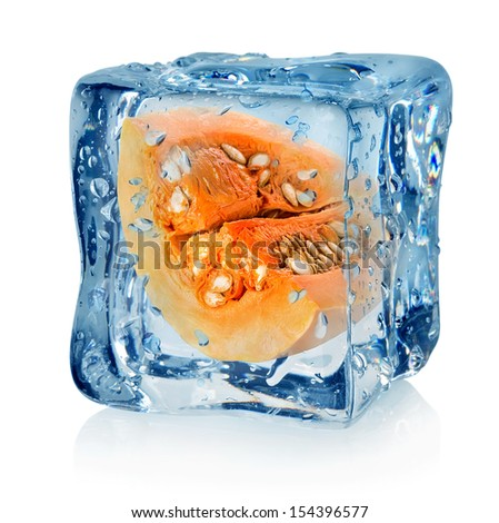 Pumpkin in ice cube isolated on a white background