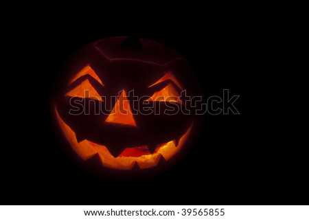 pumpkin lantern glowing in the dark