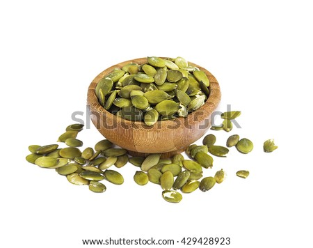 Pumpkin seed in bamboo bowl isolated